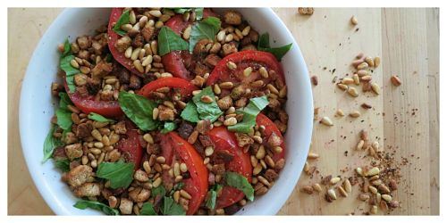 baked tomatoes with pine nuts and basil