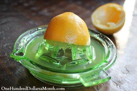 antique lemon juicer green glass