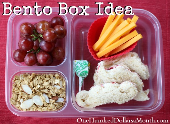 Bento Box Ideas – Peanut Butter and Jelly Sandwich, Grapes, Granola and Cheese Sticks