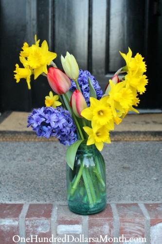 spring flowers old blue canning jar