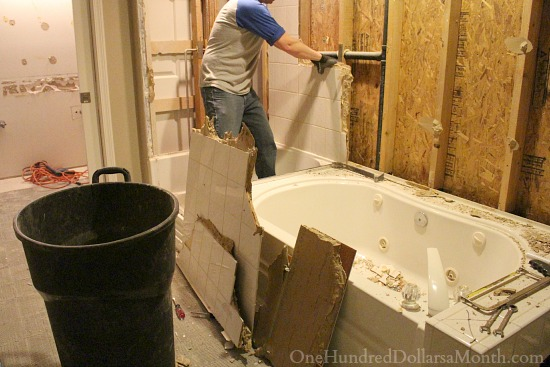 tearing out a tile wall remodel