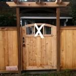 cedar fence with arbor