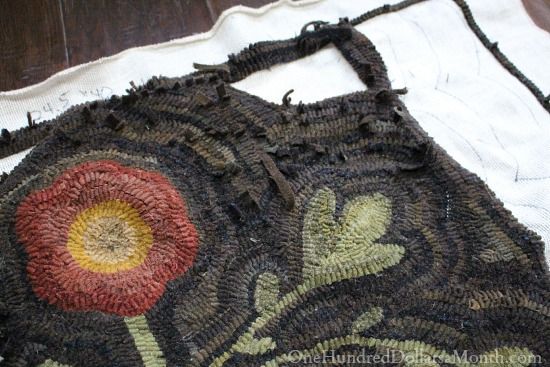 primitive hooked flower rug