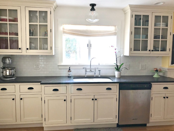 Cream Cabinets White Subway Tile Backsplash Black Countertops One Hundred Dollars A Month