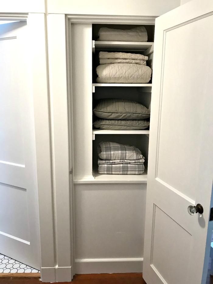 Linen Closet Makeover ~ Adios Wallpaper!